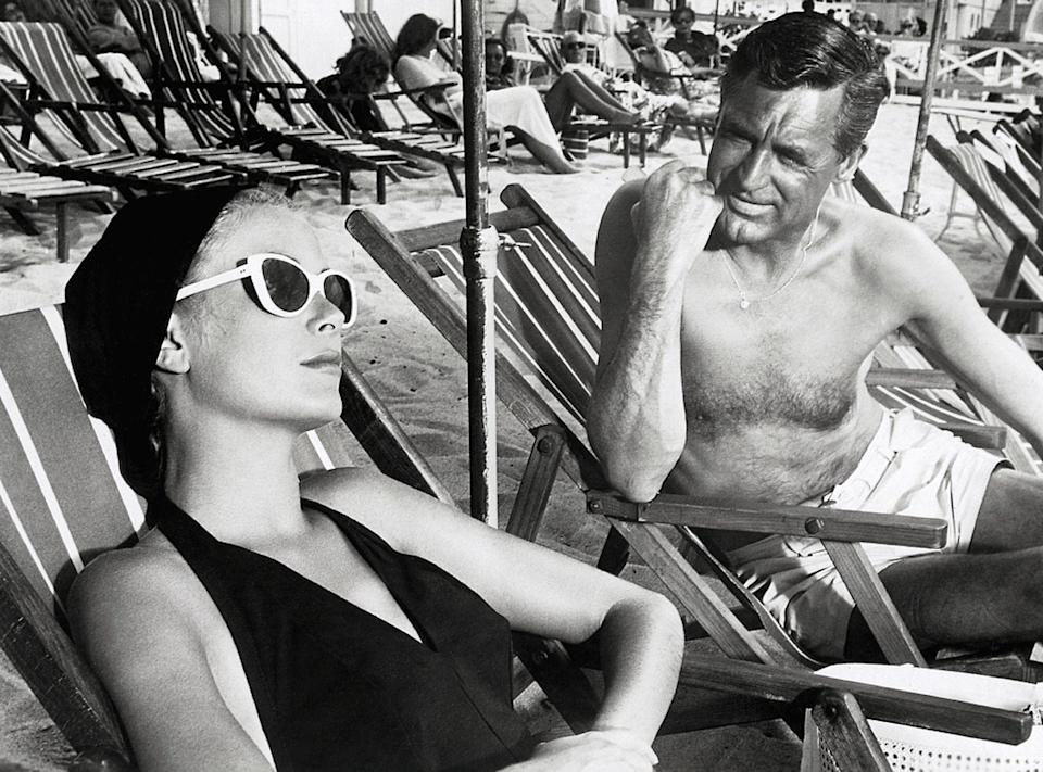 <p>In 1955, Grant returned to the big screen in a major way, starring with Grace Kelly in the Alfred Hitchcock film <em>To Catch a Thief</em>. Here, he films a scene on the beach with the actress.</p>