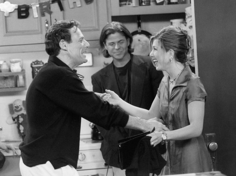 Ron on the set of Friends with his on-screen daughter, Jennifer Aniston (Photo: NBC via Getty Images)