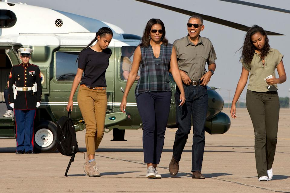 The Obamas, pictured with their daughters Sasha and Malia two years ago (Photo: ASSOCIATED PRESS)