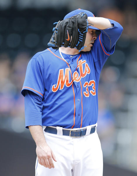 New York Mets starting pitcher Matt Harvey wipes his brow in the second inning of a baseball game against the Miami Marlins at Citi Field in New York, Saturday, June 8, 2013. (AP Photo/Paul J. Bereswill)