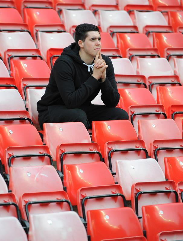 """A Manchester United fan reacts after the English Premier League football match between Sunderland and Manchester United at The Stadium of Light in Sunderland, north-east England on May 13, 2012. AFP PHOTO/ANDREW YATES RESTRICTED TO EDITORIAL USE. No use with unauthorized audio, video, data, fixture lists, club/league logos or """"live"""" services. Online in-match use limited to 45 images, no video emulation. No use in betting, games or single club/league/player publications.ANDREW YATES/AFP/GettyImages"""