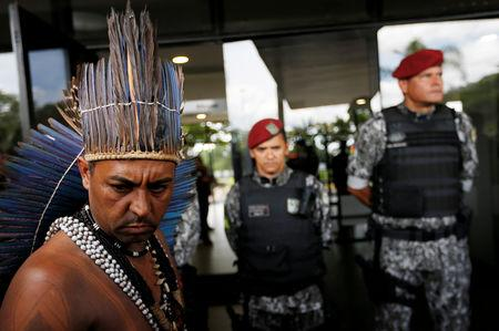 FILE PHOTO: An indigenous man is seen as he wants to deliver a letter to Brazil's President-elect Jair Bolsonaro at a transitional government building in Brasilia, Brazil, December 6, 2018. REUTERS/Adriano Machado