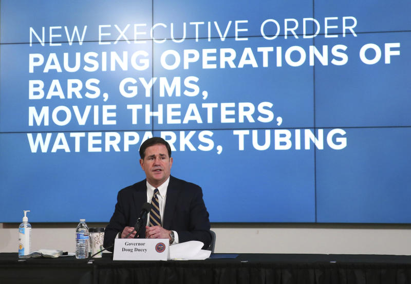 Arizona Gov. Doug Ducey announces a new executive order in response to the rising COVID-19 cases in the state, during a news conference in Phoenix on Monday, June 29, 2020. The governor ordered bars, nightclubs and water parks to close again for at least a month starting Monday night — a dramatic about-face as coronavirus cases surge in the Sunbelt. (Michael Chow/The Arizona Republic via AP, Pool)