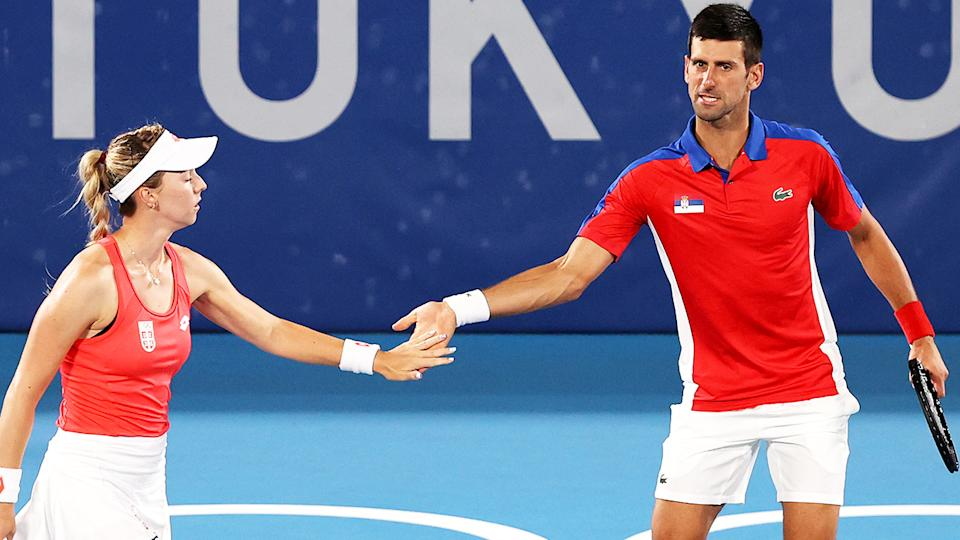 Nina Stojanovic and Novak Djokovic, pictured here in action for Team Serbia in mixed doubles.