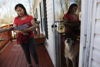 Marta Lagunes Hernandez, 49, who is originally from Mexico and whose son is a registered voter, talks with Ricky Hurtado, a Democratic candidate for the North Carolina state house, as he canvasses in a largely Latino trailer community, in Burlington, N.C., Sunday, March 8, 2020. (AP Photo/Jacquelyn Martin)