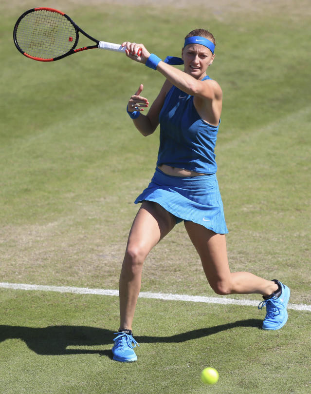 Czech Republic's Petra Kvitova plays a shot during her quarter final tennis match against Germany's Julia Goerges during day five of the Nature Valley Classic at Edgbaston Priory, Birmingham, England, Friday June 22, 2018. (Simon Cooper/PA via AP)