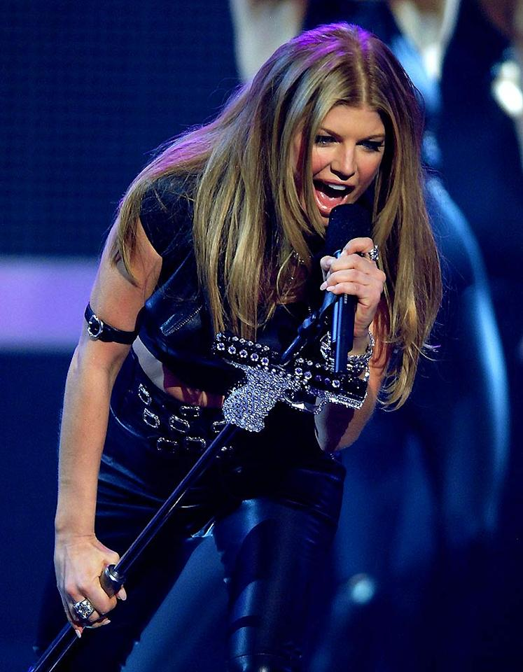 """Fergie definitely led a """"Glamorous"""" life in 2007. The BEP chanteuse struck out on a solo career that made her a household name in a matter of months as single after single from her delicious debut topped the charts. Numerous award wins and arm candy in the form of Josh Duhamel also helped the """"Dutchess"""" dominate. Michael Caulfield/<a href=""""http://www.wireimage.com"""" target=""""new"""">WireImage.com</a> - December 2, 2007"""