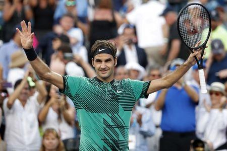 Mar 28, 2017; Miami, FL, USA; Roger Federer of Switzerland celebrates after his match against Roberto Bautista Agut of Spain (not pictured) on day eight of the 2017 Miami Open at Crandon Park Tennis Center. Federer won 7-6(5), 7-6(4). Mandatory Credit: Geoff Burke-USA TODAY Sports
