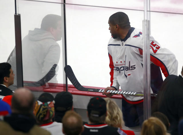 """<p> FILE - In this Feb. 17, 2018, file photo, Washington Capitals right wing Devante Smith-Pelly (25) argues from the penalty box with Chicago Blackhawks fans during the third period of an NHL hockey game in Chicago. Washington Capitals forward heard the unmistakably racial taunts from fans from inside the penalty box. As a black hockey player, he knew exactly what they meant by yelling, """"Basketball, basketball, basketball."""" (AP Photo/Jeff Haynes, File) </p>"""
