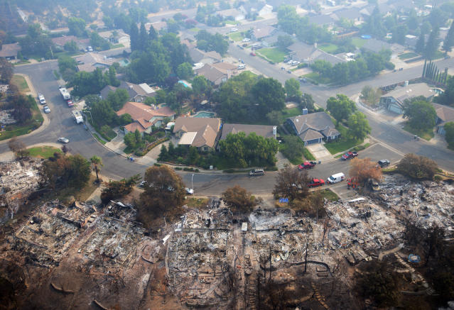 <p>Homes destroyed by a wildfire are seen from an aerial view in the Keswick neighborhood of Redding, Calif., Friday, Aug. 10, 2018. (Photo: Michael Burke/AP) </p>