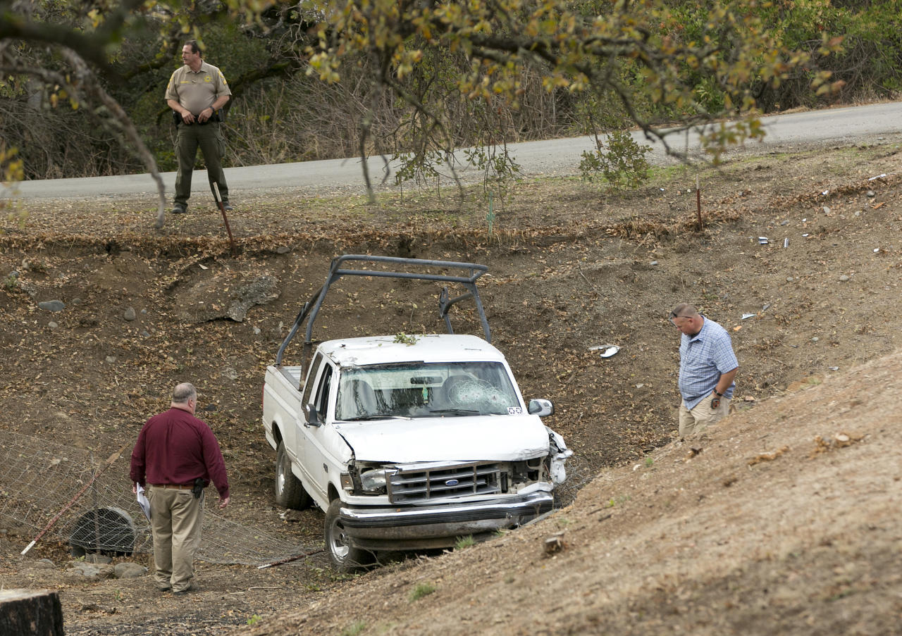 <p>Investigators view a pickup truck involved in a deadly shooting rampage at the Rancho Tehama Reserve, near Corning, Calif., Nov. 14, 2017. (Photo: Rich Pedroncelli/AP) </p>