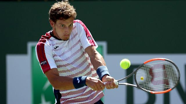 Pablo Carreno Busta and Richard Gasquet claimed straight-sets wins of contrasting difficulty at the Estoril Open.