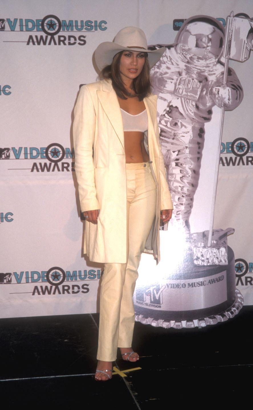 "<p>""Old Town Road,"" but make it fashion. At the MTV Video Music Awards, she wears a white bralette, pantsuit, and cowboy hat for an OTT red-carpet outfit. </p>"