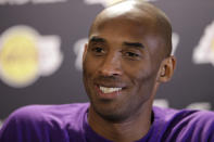 FILE - Los Angeles Lakers' Kobe Bryant speaks with members of the media ahead of a basketball game against the Philadelphia 76ers in Philadelphia, in this Tuesday, Dec. 1, 2015, file photo. Kobe Bryant, Tim Duncan and Kevin Garnett. Each was an NBA champion, an MVP, an Olympic gold medalist, annual locks for All-Star and All-Defensive teams. And now, the ultimate honor comes their way: On Saturday night, May 15, 2021, in Uncasville, Connecticut, they all officially become members of the Naismith Memorial Basketball Hall of Fame. (AP Photo/Matt Rourke, File)