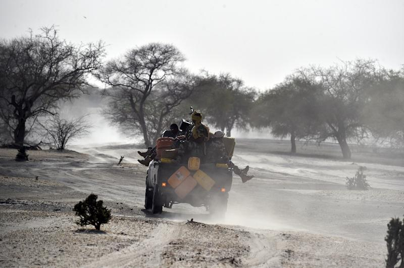 Nigerien soldiers patrol in Bosso, near the Nigerian border, on May 25, 2015