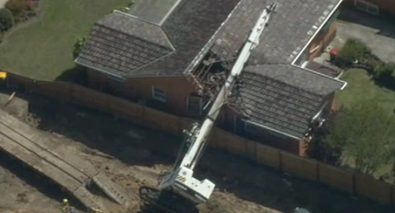 Elderly couple's near miss after construction crane crushes roof of Melbourne home