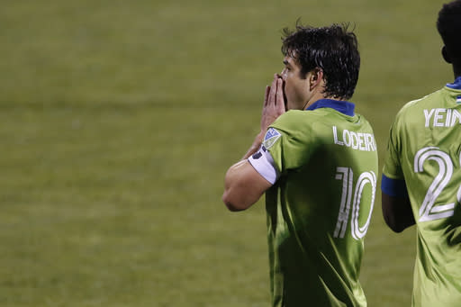 Seattle Sounders' Nicolas Lodeir reacts to missing a shot against the Columbus Crew during the second half of the MLS Cup championship game Saturday, Dec. 12, 2020, in Columbus, Ohio. The Crew won 3-0. (AP Photo/Jay LaPrete)