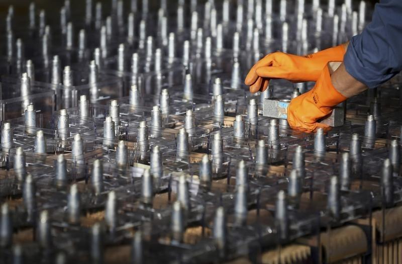 An employee prepares FIAMM batteries, in this photo illustration taken at the battery maker's factory in Avezzano, near L'Aquila