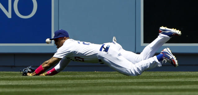 Los Angeles Dodgers center fielder Matt Kemp dives, but misses the ball on an RBI double by San Francisco Giants' Pablo Sandoval in the first inning of a baseball game on Sunday, May 11, 2014, in Los Angeles. (AP Photo/Alex Gallardo)