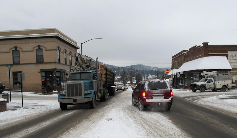In this photo taken Jan. 15, 2013 a logging truck moves through the center of St. Maries, Idaho near where a survivalist group plans to build a compound. The proposal is called the Citadel and has created a buzz among folks in this remote logging town 70 miles southeast of Spokane, Wash. The project would more than double the population of Benewah County, home to 9,000 souls. (AP Photo/Nicholas K. Geranios)