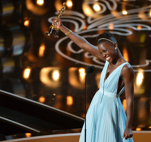 """Lupita Nyong'o accepts the award for best actress in a supporting role for """"12 Years a Slave"""" during the Oscars at the Dolby Theatre on Sunday, March 2, 2014, in Los Angeles. (Photo by John Shearer/Invision/AP)"""