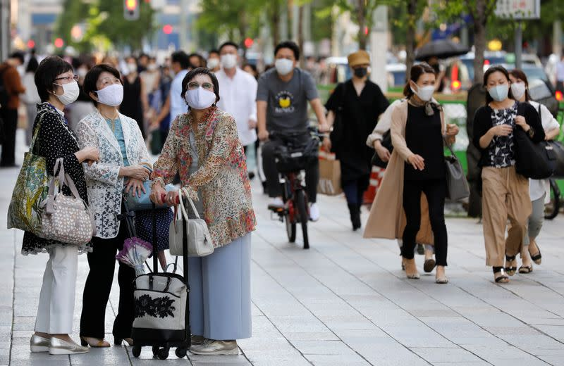 Tokyo seeks travel curbs as new infections tops 100 for third day, says NHK