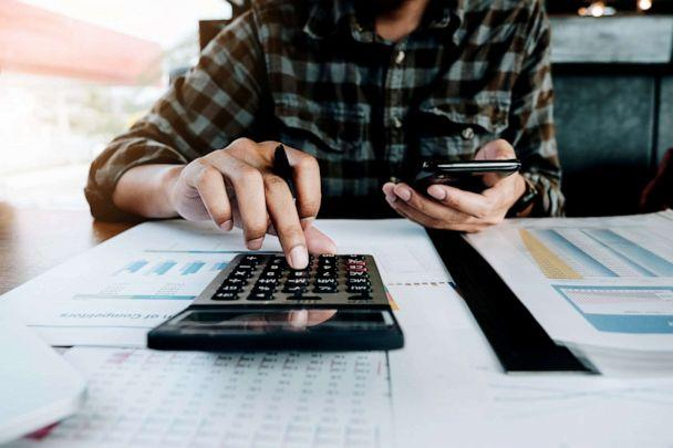 PHOTO: A calculator is used while filing paperwork in an undated stock image. (STOCK IMAGE/Natee Meepian/Getty Images)