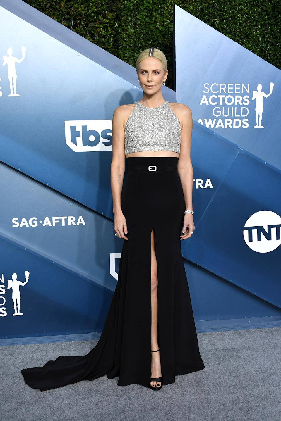 """The """"Bombshell"""" star rocked an edgy sequined crop top and belted black skirt by Givenchy."""