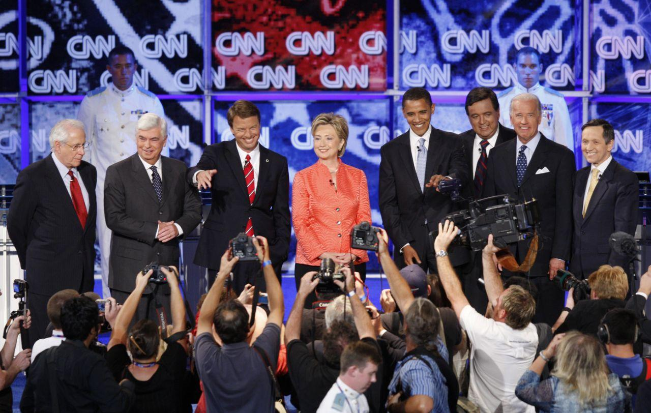 <p>Democratic presidential hopefuls, from left: former Sen. Mike Gravel, Sen. Christopher Dodd, former Sen. John Edwards, Sen. Hillary Rodham Clinton, Sen. Barack Obama, New Mexico Gov. Bill Richardson; Sen. Joseph Biden, and Rep. Dennis Kucinich get ready for a debate sponsored by CNN, YouTube and Google at The Citadel military college in Charleston, S.C., in July 2007. (Photo: Charles Dharapak/AP) </p>