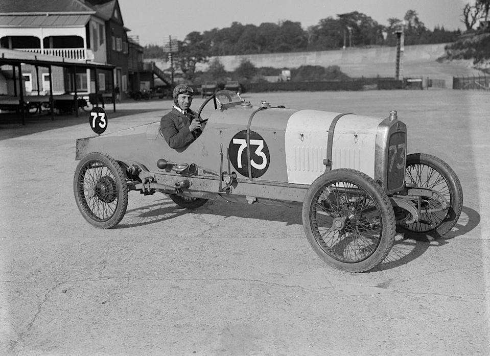 <p>A driver sits at the ready as he poses for a photograph at the Enfield-Allday 200-mile race in Surrey, England, United Kingdom.</p>