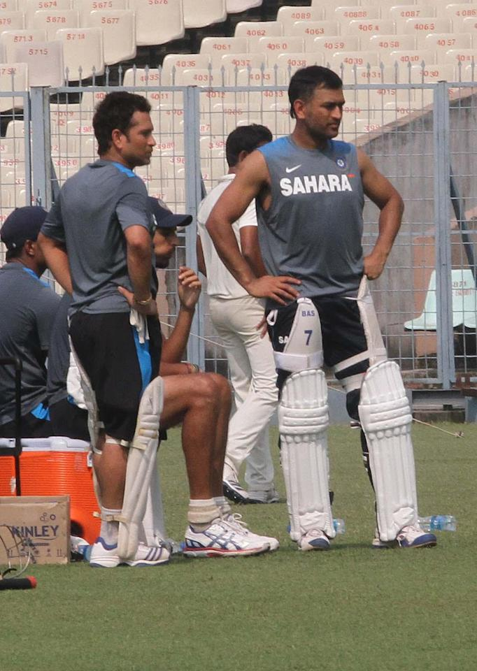 Indian cricketers Sachin Tendulkar and M S Dhoni during a practice session ahead of the test match series between India and West Indies starting on Nov 6 at Eden Gardens in Kolkata on Nov.4, 2013. (Photo: IANS)