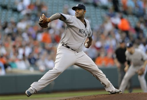 New York Yankees starting pitcher CC Sabathia throws to the Baltimore Orioles in the first inning of a baseball game in Baltimore, Monday, May 20, 2013. (AP Photo/Patrick Semansky)