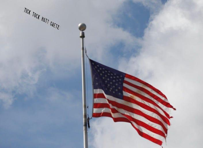 A plane trailing a banner that reads 'Tick Tock Matt Gaetz' flies over the Federal Courthouse in Orlando on Monday as former Seminole County tax collector Joel Greenberg pleaded guilty