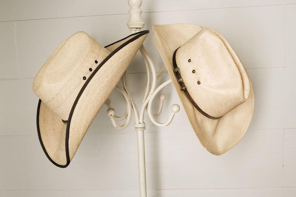 """<p>If you've got an old cowboy hat laying around from the """"Urban Cowboy"""" era or earlier, it could fetch as much as <a href=""""https://go.redirectingat.com?id=74968X1596630&url=https%3A%2F%2Fwww.ebay.com%2Fsch%2Fi.html%3F_from%3DR40%26_trksid%3Dp2334524.m570.l2632.R3.TR12.TRC2.A0.H0.Xcowboy%2Bhat%2Bvin.TRS0%26_nkw%3Dcowboy%2Bhat%2Bvintage%26_sacat%3D175759%26LH_TitleDesc%3D0%26_osacat%3D0%26_odkw%3Dcowboy%2Bhat%26LH_Complete%3D1%26LH_Sold%3D1&sref=https%3A%2F%2Fwww.goodhousekeeping.com%2Flife%2Fg35334508%2Fvaluable-antiques-basement%2F"""" rel=""""nofollow noopener"""" target=""""_blank"""" data-ylk=""""slk:$150 on eBay"""" class=""""link rapid-noclick-resp"""">$150 on eBay</a> if it's in good condition, with its original band.</p>"""