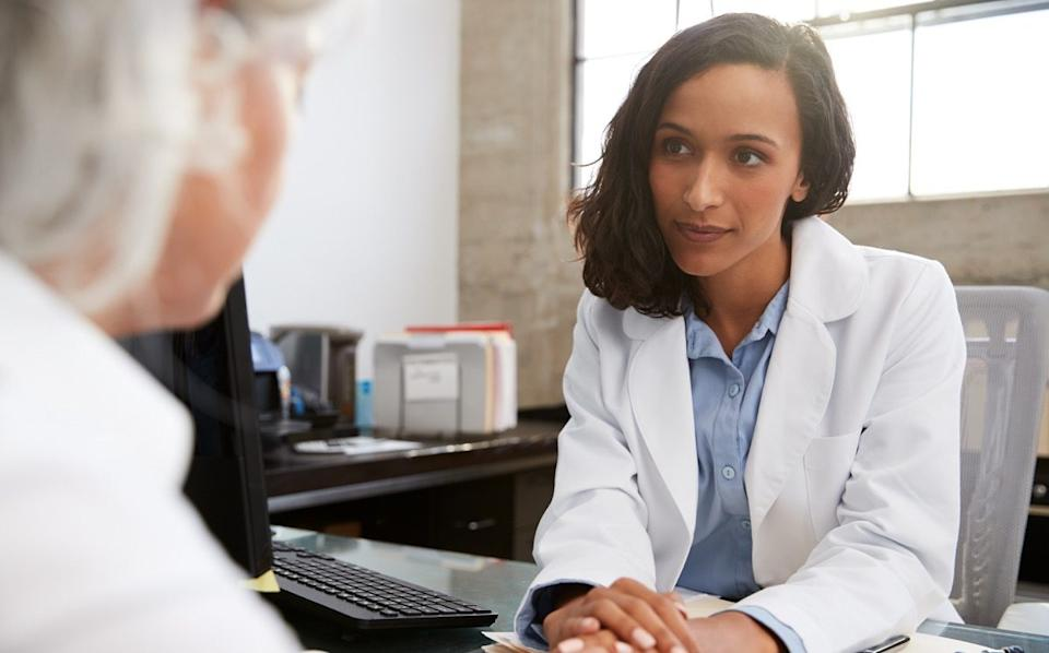 Doctor talking to woman with serious tone