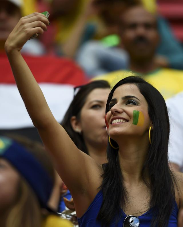A fan takes a selfie before the 2014 World Cup round of 16 game between France and Nigeria at the Brasilia national stadium in Brasilia June 30, 2014. REUTERS/Dylan Martinez (BRAZIL - Tags: SOCCER SPORT WORLD CUP)