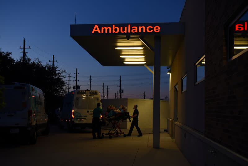 FILE PHOTO: An Orion EMS ambulance transports patients amidst the COVID-19 pandemic in Houston