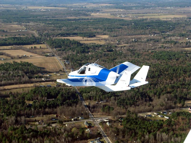 This March 23, 2012 photo provided by Terrafugia Inc. shows the company's prototype flying car, dubbed the Transition, during its first flight. The vehicle has two seats, four wheels and wings that fold up so it can be driven like a car, and flew at 1,400 feet for eight minutes during the test. Commercial jets fly at 35,000 feet. (AP Photo/Terrafugia.com) MANDATORY CREDIT