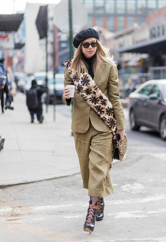 <p>Dress like a Parisian by pairing a light khaki suit with a chic beret, furry bag, and winter boots. If it's extra frigid that day, throw on a minimalist overcoat in grey or tan. (Photo: Getty) </p>