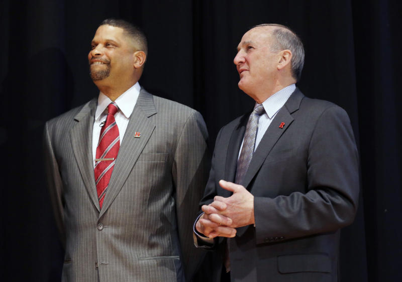 Rutgers President Robert Barchi, right, stands with new Rutgers head coach Eddie Jordan during an NCAA college basketball news conference Tuesday, April 23, 2013, in New Brunswick, N.J. Rutgers turned to Jordan, who played for the Scarlet Knights from 1973-77 and was a member of Rutgers' Final Four team in 1976, for the position as it seeks to move forward from a scandal that forced the firing of coach Mike Rice and the resignation of athletic director Tim Pernetti. (AP Photo/Mel Evans)