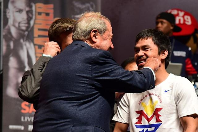 """Boxing promoter Bob Arum gives Manny Pacquiao a playful jab on the cheek in May, on the eve of his """"Fight of the Century"""" against Floyd Mayweather (AFP Photo/Frederic J. Brown)"""