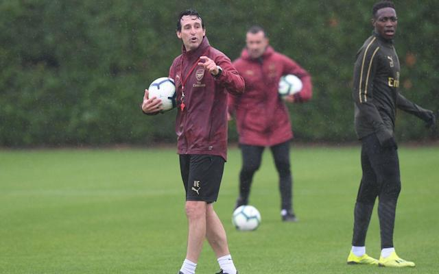 Unai Emery issues instructions on the Arsenal training pitch last week - Arsenal FC