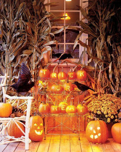 "<p>Use a drill to punch out a phrase on hollow pumpkins. The trick to a supernatural glow? A bundle of Christmas lights tucked in each gourd.</p><p>Get the tutorial at <em><a href=""http://www.countryliving.com/diy-crafts/g1370/outdoor-halloween-decorations/"" rel=""nofollow noopener"" target=""_blank"" data-ylk=""slk:Country Living"" class=""link rapid-noclick-resp"">Country Living</a>.</em></p>"