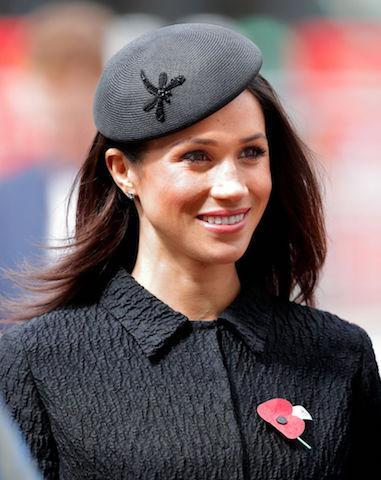 <p>On April 25, Meghan commemorated Anzac Day for the first time. For the afternoon's service, she dressed in a textured ensemble by Emilia Wickstead. She finished the look with sleek hair and a coordinating Philip Treacy hat. (Photo: Getty Images) </p>