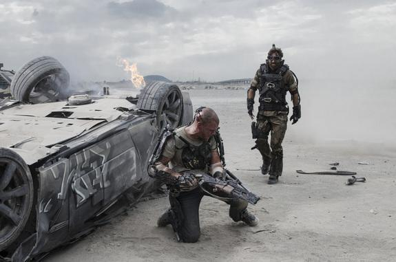 """Matt Damon (left) and Sharlto Copley in Columbia Pictures' """"Elysium,"""" which opens on August 9, 2013."""