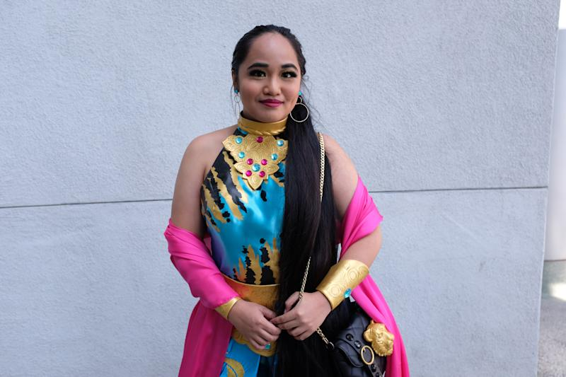 Sami Isidro wearing a re-creation of a limited-edition Princess Jasmine doll that she sewed herself