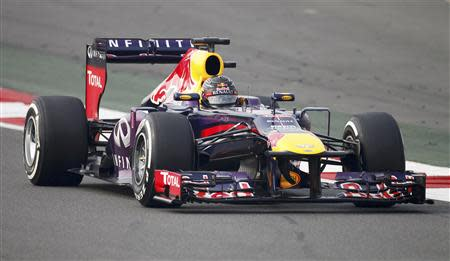 Red Bull Formula One driver Sebastian Vettel of Germany drives during the qualifying session of the Indian F1 Grand Prix at the Buddh International Circuit in Greater Noida, on the outskirts of New Delhi, October 26, 2013. REUTERS/Anindito Mukherjee