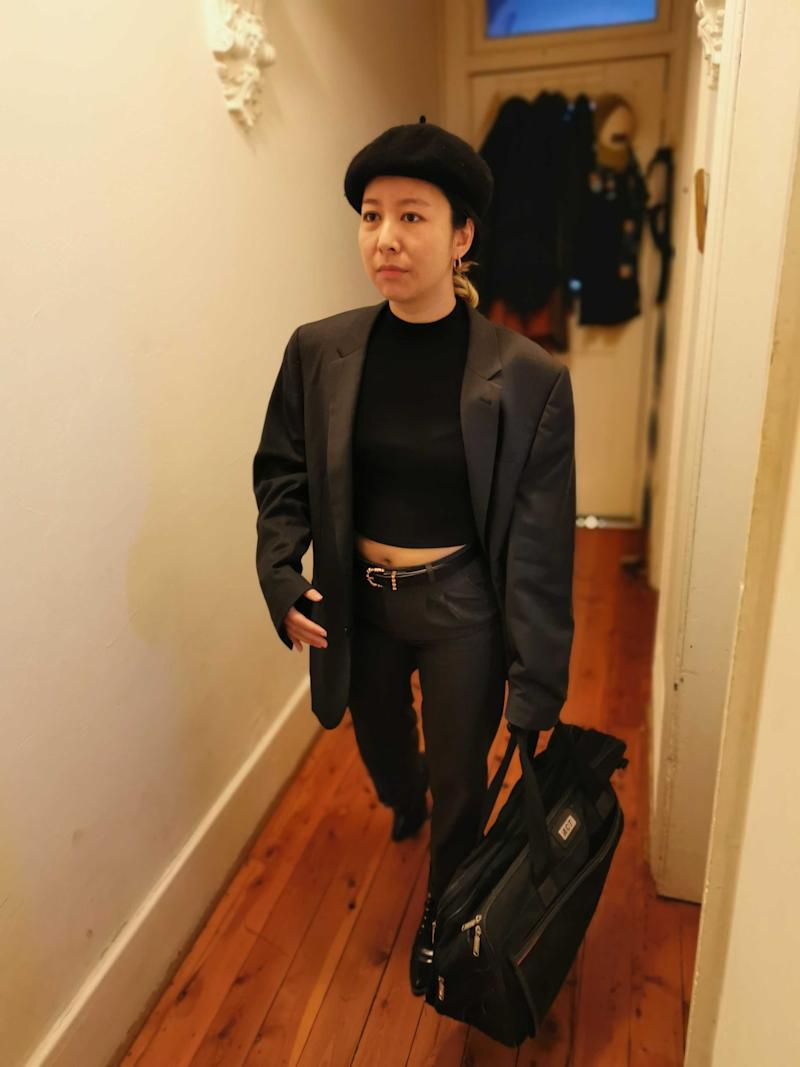 Louise Cheer dressed as 1997 Michael Jordan in a beret and an oversized suit.