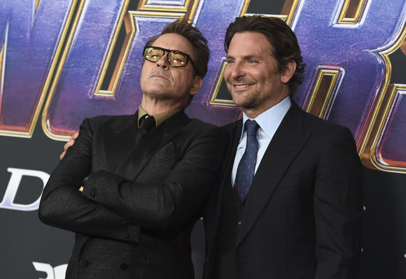 "Robert Downey Jr., left, and Bradley Cooper arrive at the premiere of ""Avengers: Endgame"" at the Los Angeles Convention Center on Monday, April 22, 2019. (Photo by Jordan Strauss/Invision/AP)"