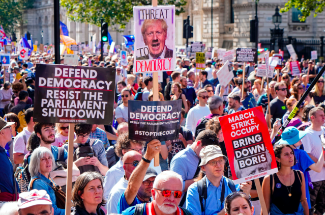 """Boris Johnson <a href=""""https://uk.yahoo.com/poll/61a2fb80-d636-11e9-8909-096633f09171"""" data-ylk=""""slk:caused uproar for proroguing Parliament"""" class=""""link rapid-noclick-resp""""><strong>caused uproar for proroguing Parliament</strong></a> in October, which many believed he did to allow a no-deal Brexit. Protests about a 'coup' took place but MPs went straight back to work after Mr Johnson's actions <a href=""""https://uk.news.yahoo.com/supreme-court-ruling-boris-johnson-parliament-suspension-unlawful-094210047.html"""" data-ylk=""""slk:were deemed 'unlawful';outcm:mb_qualified_link;_E:mb_qualified_link;ct:story;"""" class=""""link rapid-noclick-resp yahoo-link""""><strong>were deemed 'unlawful'</strong></a> by the courts. (Getty)"""
